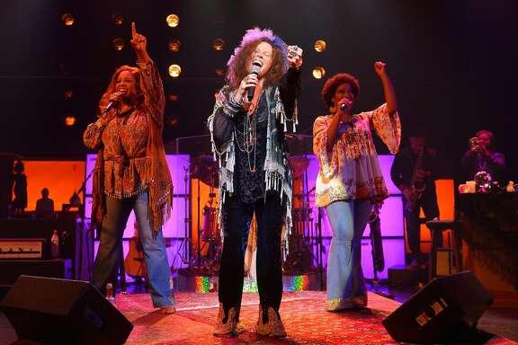"Kacee Clanton (center) as Janis Joplin accompanied by Sylvia MacCalla and Ashley Ta�mar Davis as Joplinaires in ""A Night with Janis Joplin"" at ACT."