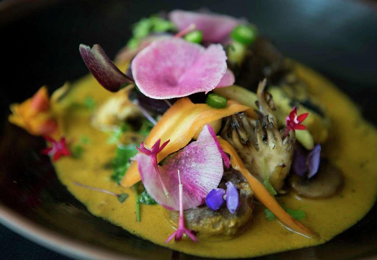 The Hongos at Xochi consists of wild mushrooms, a notable and delicate mole amarillo, masa dumplings and green beans.