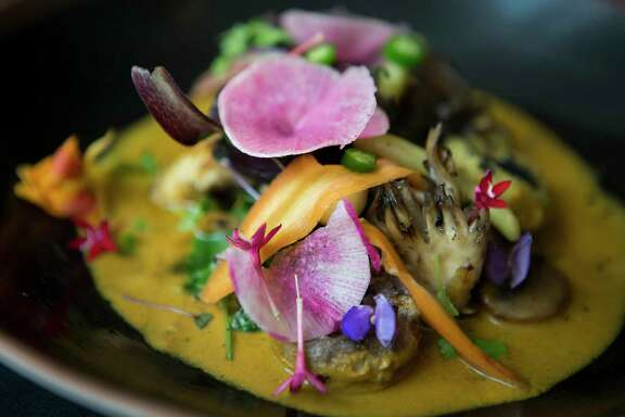 The Hongos dish from Xochi, is made out mushrooms, mole amarillo, masa dumplings and green beans. Monday, June 5, 2017, in Houston. ( Marie D. De Jesus / Houston Chronicle )