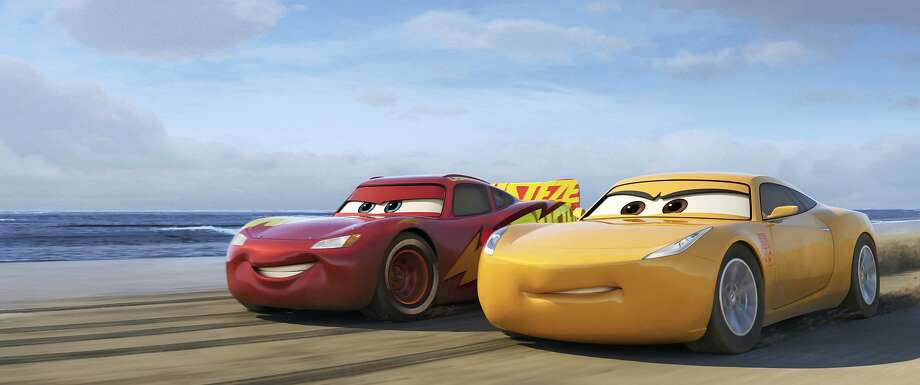 """This image released by Disney shows Lightning McQueen, voiced by Owen Wilson, left, and Cruz Ramirez, voiced by Cristela Alonzo in a scene from """"Cars 3."""" (Disney-Pixar via AP) Photo: Pixar, Associated Press"""