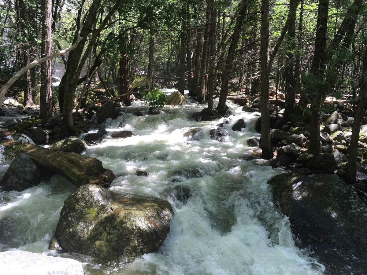 In this photo taken May 25, 2017, the water in Bridalveil Creek rushes through boulders at Yosemite National Park, Calif. Massive waterfalls in Yosemite National Park and rivers raging in mountains throughout the western United States are thundering with greater force than they have for years, and proving deadly as warm weather melts the deepest mountain snowpack in recent memory. (AP Photo/Scott Smith)
