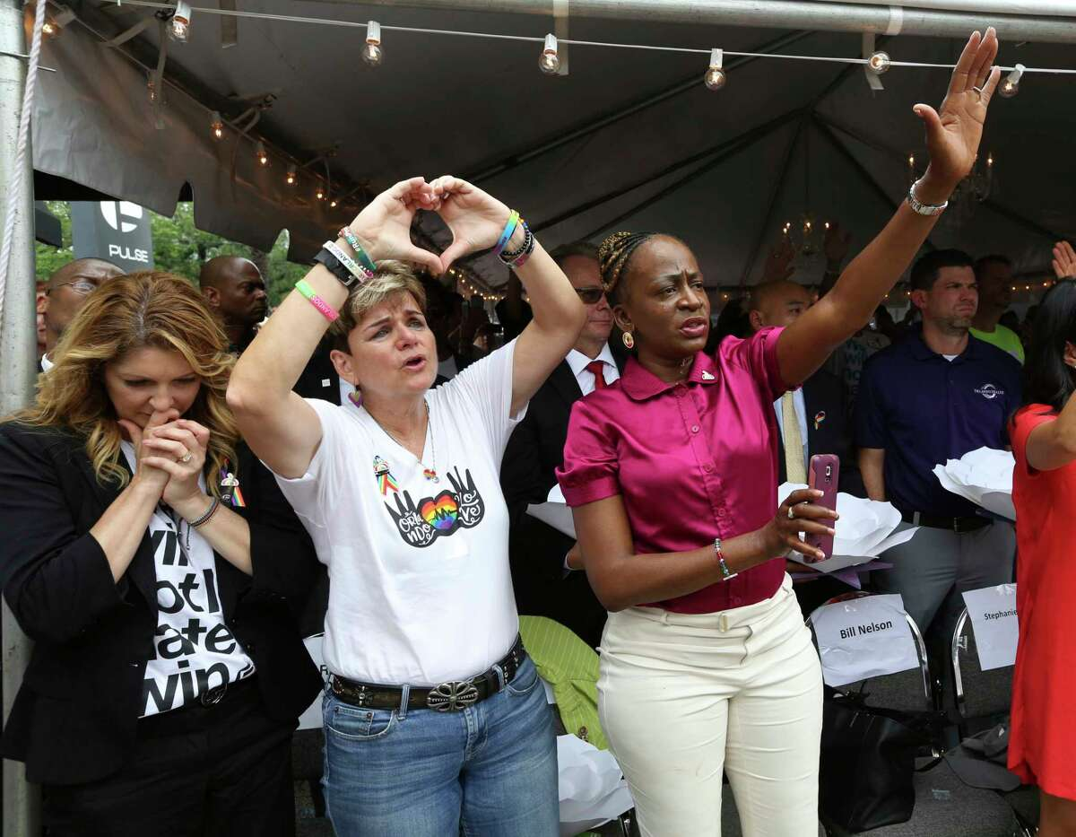 Pulse nightclub owner Barbara Poma, from left, and Orlando city commissioners Patty Sheehan and Regina Hill attend a ceremony Monday at the Pulse nightclub, commemorating the 49 victims killed in the June 12, 2016, shooting there.