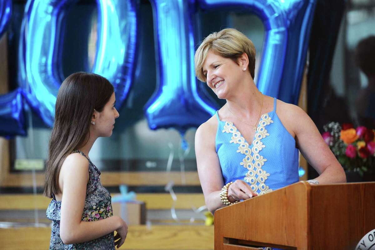 Dr. Laura Greene, right, gives a warm smile to Karen Porphirio after awarding her an academic achievement award during the Alternative Routes to Success graduation ceremony in Government Center in Stamford, Conn. on Monday, June 12, 2017.