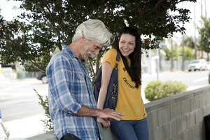 """This image released by The Orchard shows Sam Elliott, left, and Laura Prepon in a scene from, """"The Hero."""" (Beth Dubber/The Orchard via AP)"""