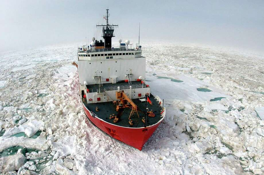 In a photo provided by the U.S. Coast Guard, the Coast Guard Cutter Healy breaks ice to support scientific research in the Arctic Ocean near Barrow, Alaska, Saturday, July 22, 2006. The 420-foot polar icebreaker, whose home port is in Seattle, is halfway through a four-month deployment, in which it is used as a platform for science conducted in the Arctic region. (AP Photo/U.S. Coast Guard, Prentice Danner) Photo: PRENTICE DANNER, HO / AP / U.S. COAST GUARD