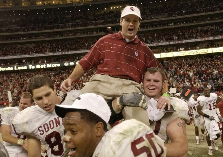 In this Dec. 7, 2002, file photo, Oklahoma players carry off coach Bob Stoops after winning the Big 12 championship with a 29-7 win over Colorado, in Houston. Stoops has decided to retire as Oklahoma's football coach after 18 seasons that included the 2000 national championship and 10 Big 12 Conference titles. Photo: Brett Coomer /AP Photo