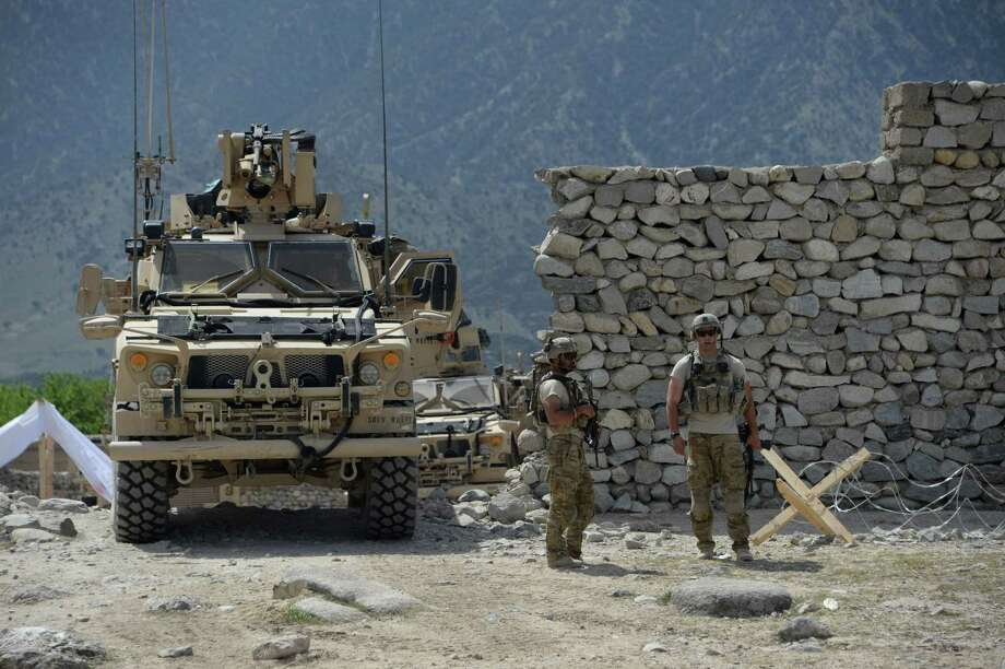 """US soldiers patrol near the site of a US bombing during an operation against Islamic State (IS) militants in the Achin district of Afghanistan's Nangarhar province on April 15, 2017. Afghan authorities April 15 reported a jump in fatalities from the American military's largest non-nuclear bomb, declaring some 90 Islamic State fighters dead, as US-led forces conducted clean-up operations over their mountain hideouts. Dubbed the """"Mother Of All Bombs"""", the GBU-43/B Massive Ordnance Air Blast was unleashed in combat for the first time April 12, hitting IS positions in a remote area of eastern Nangarhar province. / AFP PHOTO / NOORULLAH SHIRZADANOORULLAH SHIRZADA/AFP/Getty Images Photo: NOORULLAH SHIRZADA, Stringer / AFP/Getty Images / AFP or licensors"""