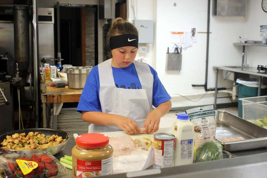 Laker cook-off contestant Hannah Helmuth prepares turkey rolls, stuffed with homemade stuffing and topped with cheese and creamy soup. Photo: Submitted Photo