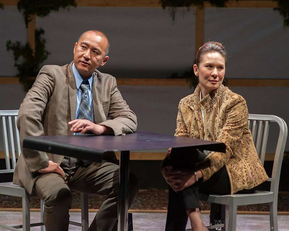 """Don Castro (left) plays Daniel and Charisse Loriaux plays Samantha in San Francisco Playhouse's """"You Mean to Do Me Harm,"""" about spouses who make deft attacks. Photo: Ken Levin, San Francisco Playhouse"""