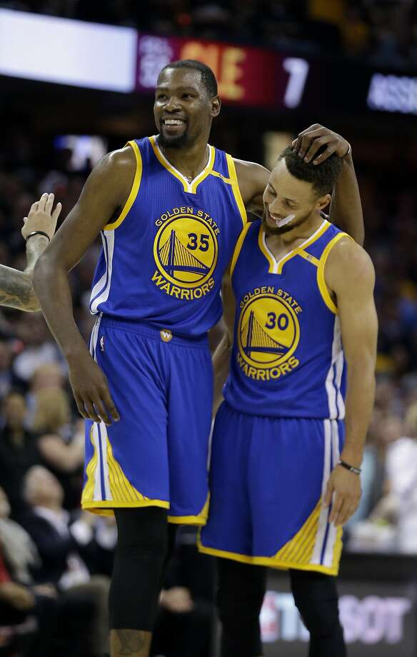 Golden State Warriors' Kevin Durant (35) hugs teammate Stephen Curry (30) during the first half of Game 4 of basketball's NBA Finals against the Cleveland Cavaliers in Cleveland, Friday, June 9, 2017. (AP Photo/Tony Dejak) Photo: Tony Dejak, Associated Press