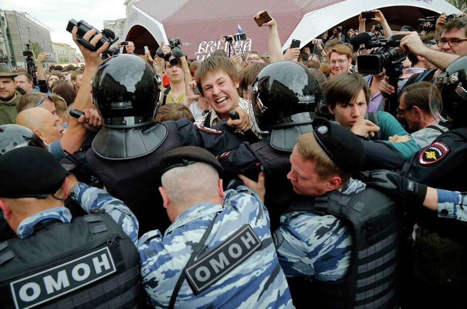 Protestors are blocked during a demonstration in downtown Moscow on Monday. Russian opposition leader Alexei Navalny, the architect of the protests, was arrested as he went to a rally. Photo: Alexander Zemlianichenko, STF / Copyright 2017 The Associated Press. All rights reserved.