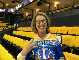 "Robin Schreiber, aka ""Sweater Mom"" or ""Dance Cam Mom,"" before Game 5 of the NBA Finals in Oakland, June 12, 2017. (Al Saracevic/San Francisco Chronicle)"
