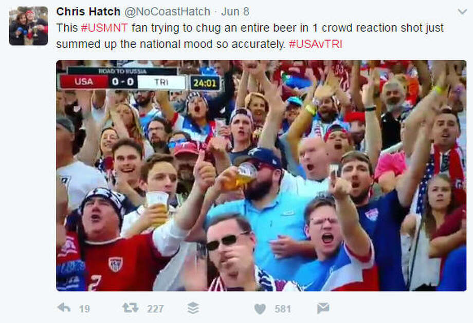 An Astros fan at the USMNT soccer game downs a beer like a champ. (Chris Hatch/Twitter)>>This guy is legit but here's a guide to spotting a new, bandwagon Astros fan...