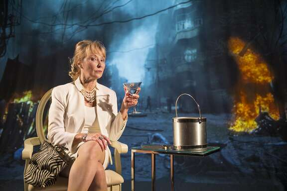 """The First Lady (Lorri Holt) icily sips her martini as the revolution rages outside in Aurora Theatre's """"Splendour."""""""