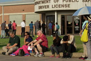 People wait in line for the Texas Department of Public Safety Driver License building to open Monday, June 12, 2017, in Houston. Hours of operations for the building have been reduced at major DPS offices.