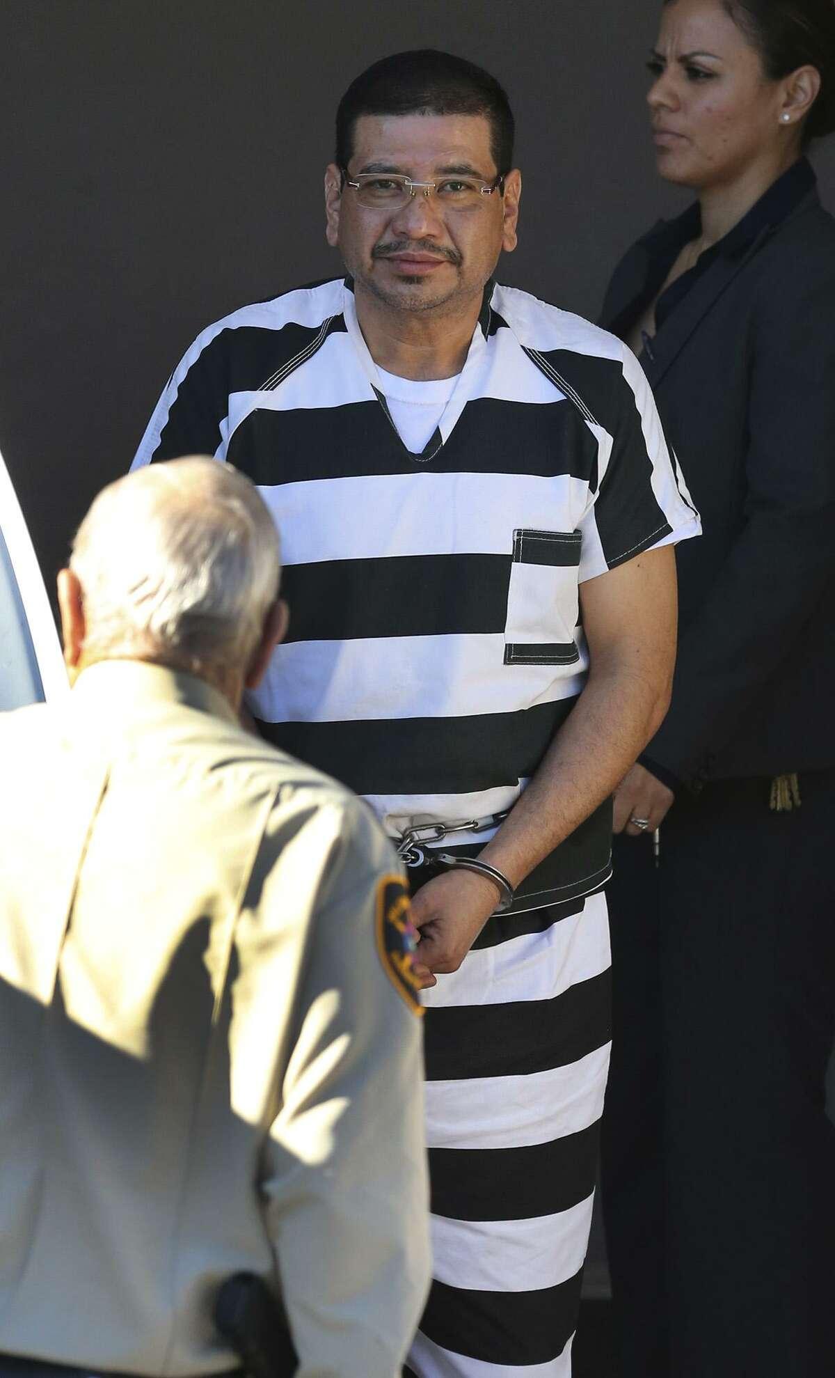 Reymundo Villarreal Arelis (center) is escorted to a van Jan. 23, 2017 at the John Wood Jr. Federal Courthouse.