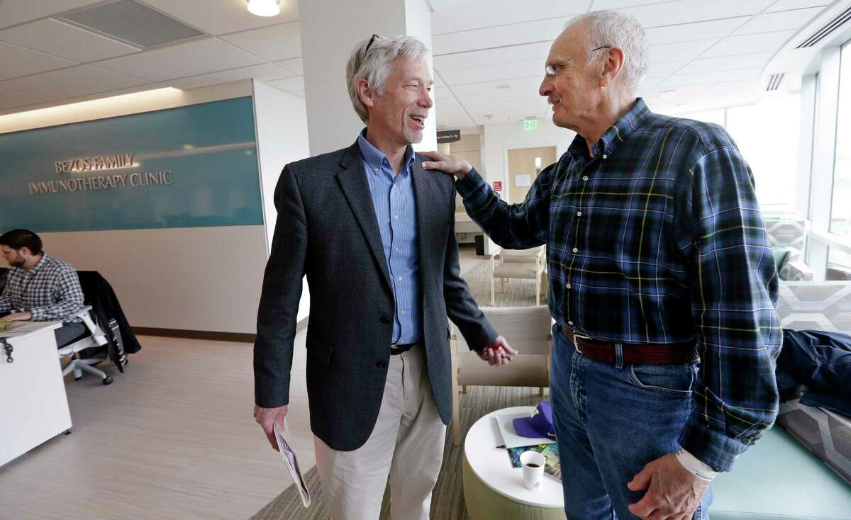 In this photo taken March 29, 2017, Dr. David Maloney of the Fred Hutchinson Cancer Research Center is greeted by patient Ken Shefveland, whose lymphoma was successfully treated with CAR-T cell therapy. Immune therapy is the hottest trend in cancer care and its next frontier is creating