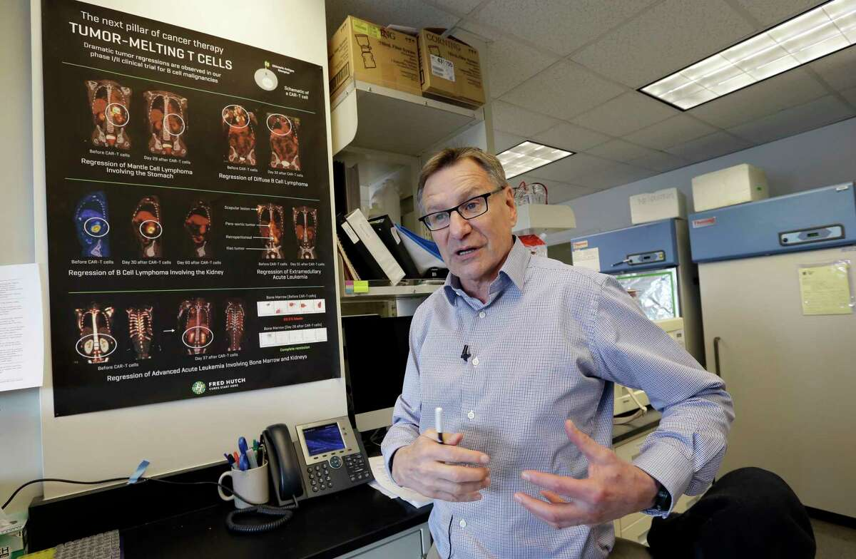 In this photo taken March 28, 2017, Dr. Stanley Riddell describes how a patient's large tumor rapidly shrank in an immunotherapy study at the Fred Hutchinson Cancer Research Center in Seattle. Riddell's team studies