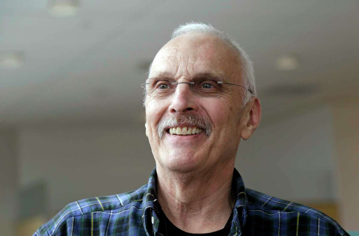 In this photo taken March 29, 2017, Ken Shefveland smiles as he talks about the success of his treatment in a research study run by the Fred Hutchinson Cancer Research Center in Seattle. Shefveland had some of his immune cells genetically reprogrammed into an army of