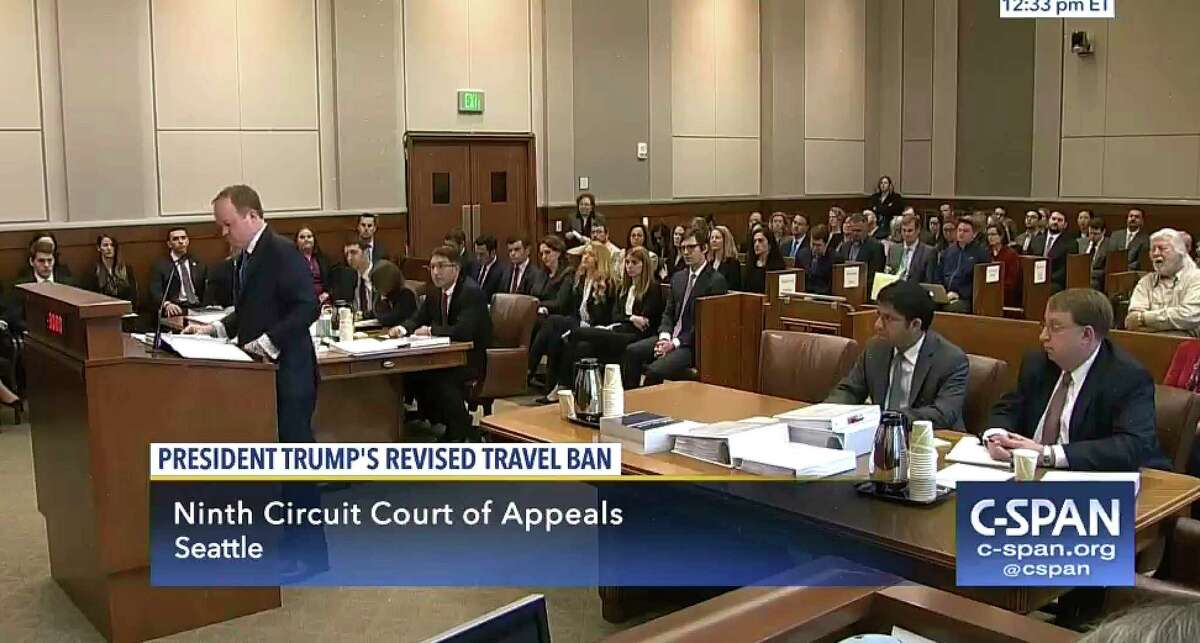 FILE--In this May 15, 2017, file image made from a C-SPAN video, Acting Solicitor General Jeffrey Wall, standing at left, presents his arguments during a 9th Circuit Court of Appeals panel in Seattle, Monday, May 15, 2017. On Monday a three-judge panel of the 9th Circuit Court of Appeals upheld a decision blocking President Donald Trump's revised travel ban. The judges said the president violated U.S. immigration law by discriminating against people based on their nationality and that Trump failed to show their entry into the country would hurt American interests. (CSPAN via AP, Pool, file)