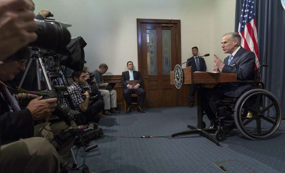 Gov. Greg Abbott used line-item vetoes to cut about $120 million out of the $217 billion budget, which he signed Monday. Abbott is shown at a June 6 news conference. Photo: Stephen Spillman /For The San Antonio Express-News / stephenspillman@me.com Stephen Spillman