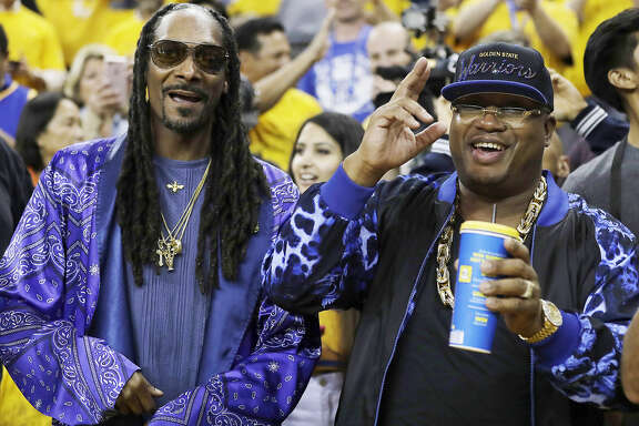 Musicians Snoop Dogg, left, and E-40 pose for photos before Game 5 of basketball's NBA Finals between the Golden State Warriors and the Cleveland Cavaliers in Oakland, Calif., Monday, June 12, 2017. (AP Photo/Marcio Jose Sanchez)