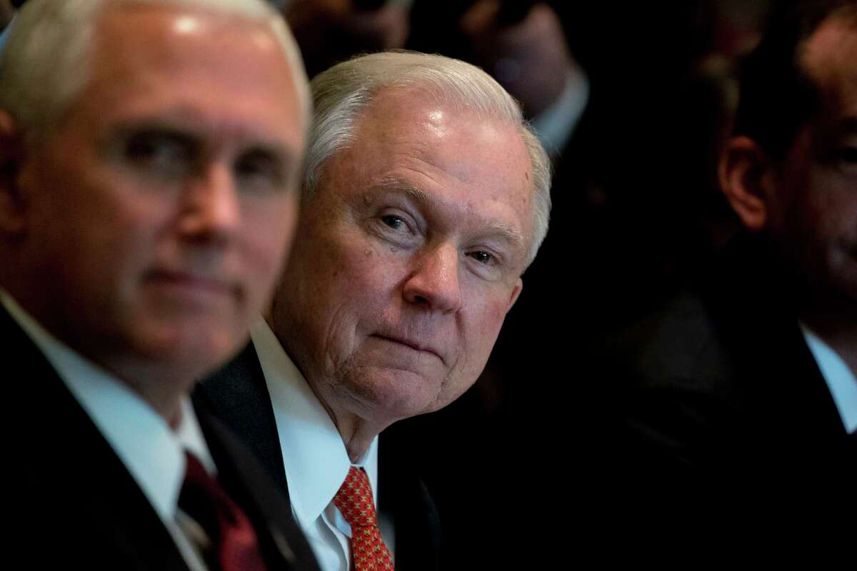 Attorney General Jeff Session, right, and Vice President Mike Pence attend a Cabinet meeting with President Donald Trump, Monday, June 12, 2017, in the Cabinet Room of the White House in Washington. (AP Photo/Andrew Harnik)