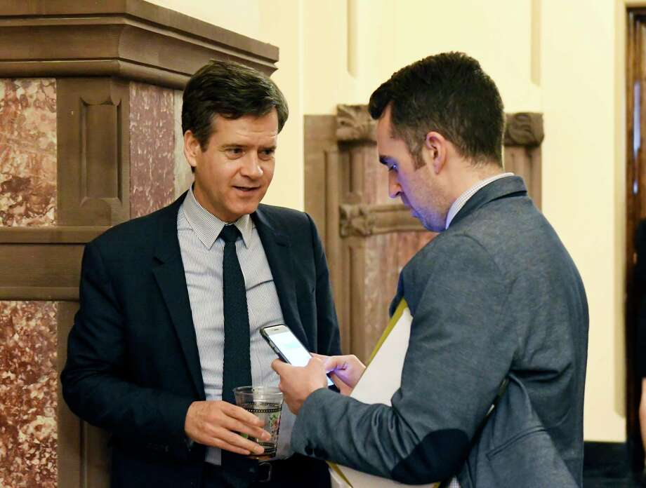 Sen. Brad Hoylman, D-New York, left, talks with staff counsel Burton Phillips as legislative leaders work on the state budget at the state Capitol, Sunday, April 2, 2017, in Albany, N.Y. (AP Photo/Hans Pennink) ORG XMIT: NYHP101 Photo: Hans Pennink / FR58980 AP