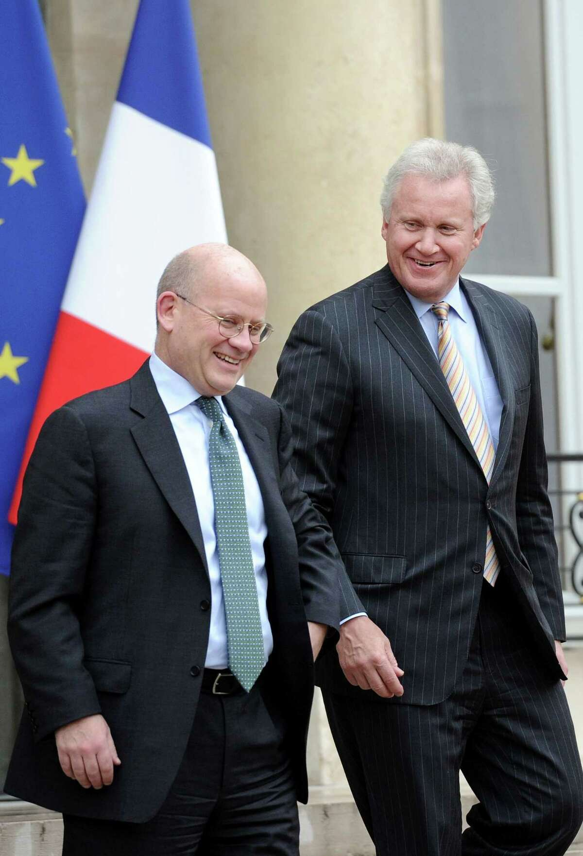 (FILES) This file photo taken on May 28, 2014 shows General Electric (GE) chief executive Jeffrey Immelt (R), flanked by Vice President, Corporate Business Development at GE, John Flannery leaving the Elysee Palace in Paris. General Electric on June 12, 2017, announced the departure of Immelt, who had made the risky bet of refocusing the US conglomerate on its industrial roots, particularly energy. Immelt, 61, who has served in the role since 2001, will hand his chief executive position over to Flannery on August 1, the company said in a news release. (STEPHANE DE SAKUTIN/AFP/Getty Images)
