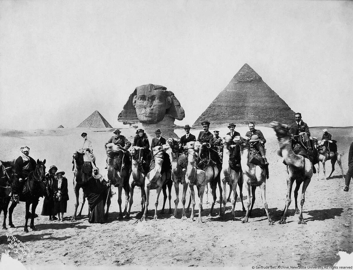 Gertrude Bell is seated on a camel underneath the left eye of the Sphinx between Winston Churchill and T.E, Lawrence in a scene from the documentary