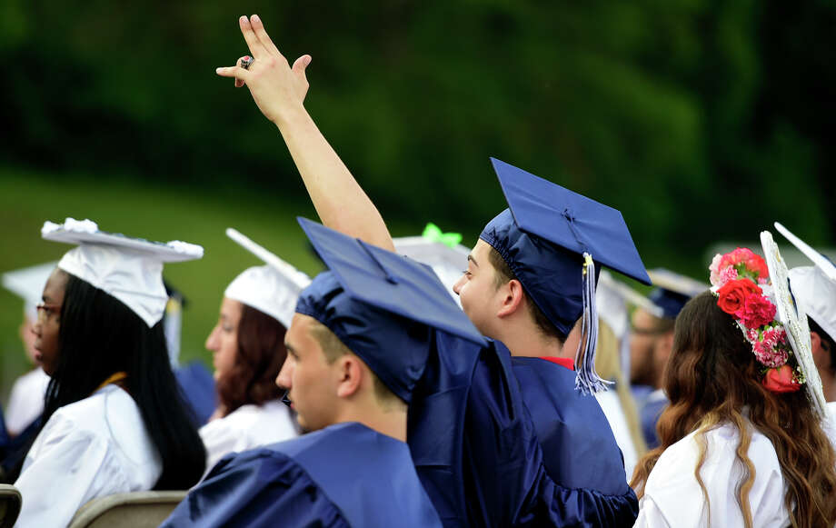 Joshua Luna waves to the bleachers during the Ansonia High School Class of 2017 Commencement exercises at Jarvis Field in Ansonia, Conn. on Monday, June 12, 2017. Photo: Peter Hvizdak, Hearst Connecticut Media / Connecticut Post