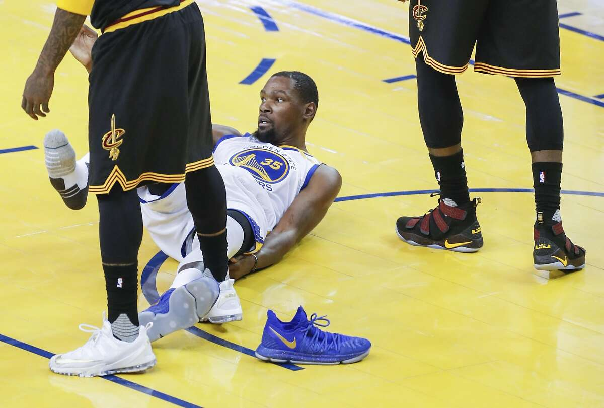 Golden State Warriors' Kevin Durant's shoe came off in the first quarter during Game 5 of the 2017 NBA Finals at Oracle Arena on Monday, June 12, 2017 in Oakland, Calif.