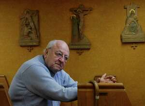 Father Peter Young sits inside St. Mary's Chapel in the basement of the Picot Building on Thursday, March 9, 2017, in Albany, N.Y.  Father Young holds a noon time mass in the chapel Monday through Friday each week.    (Paul Buckowski / Times Union)