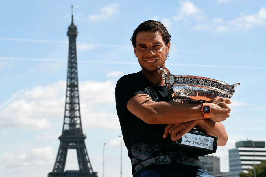 TOPSHOT - Spain's Rafael Nadal poses with the winner's trophy a day after he won the men's Roland Garros 2017 French Open on June 12, 2017 in Paris, with the Eiffel Tower in Background.  / AFP PHOTO / CHRISTOPHE SIMONCHRISTOPHE SIMON/AFP/Getty Images Photo: CHRISTOPHE SIMON / AFP or licensors