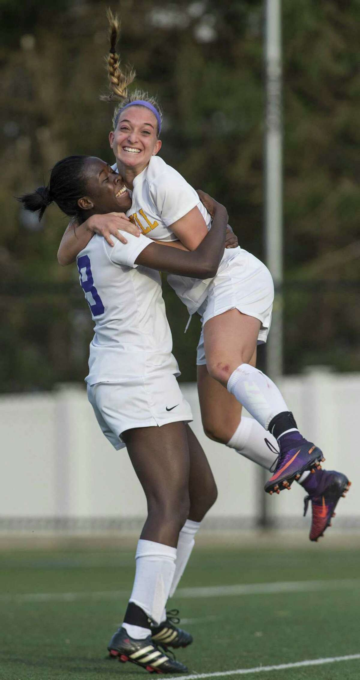 Westhill's Chelsea Domond, left, and Claudia Benz celebrate after Chelsea scored a goal in a CIAC class LL girls soccer quarterfinal against Wilton on Nov. 14, 2016. Domond and teammate Natalie Druehl have been playing together since they were on an under-8 team.