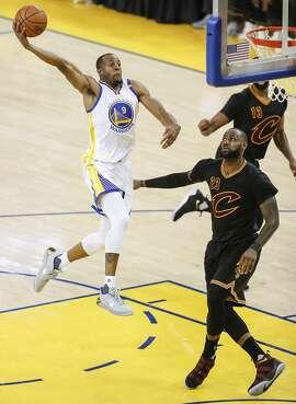 Golden State Warriors' Andre Iguodala goes up for a dunk in the second quarterduring Game 5 of the 2017 NBA Finals at Oracle Arena on Monday, June 12, 2017 in Oakland, Calif.
