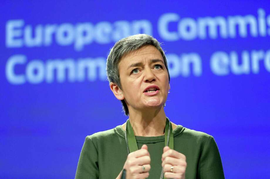 European Commissioner for Competition Margrethe Vestager speaks during a media conference at EU headquarters in Brussels on Wednesday, Dec. 7, 2016. European Union regulators on Wednesday fined banks JPMorgan Chase, HSBC and Credit Agricole a combined $520 million for colluding to manipulate the price of financial products linked to interest rates. (AP Photo/Thierry Monasse) Photo: Thierry Monasse, STR / Copyright 2016 The Associated Press. All rights reserved.