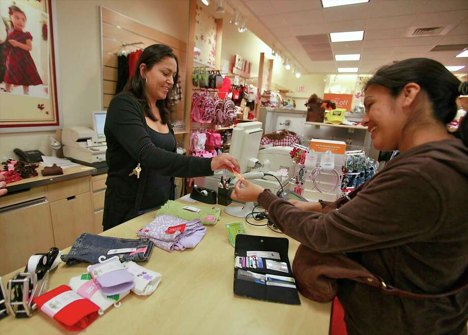 In this 2010, file photo, Susi Ortiz, right, buys children's clothing at the Gymboree store at the Westside Pavilion Shopping Center in Los Angeles.  Photo: Damian Dovarganes, STF / AP2010