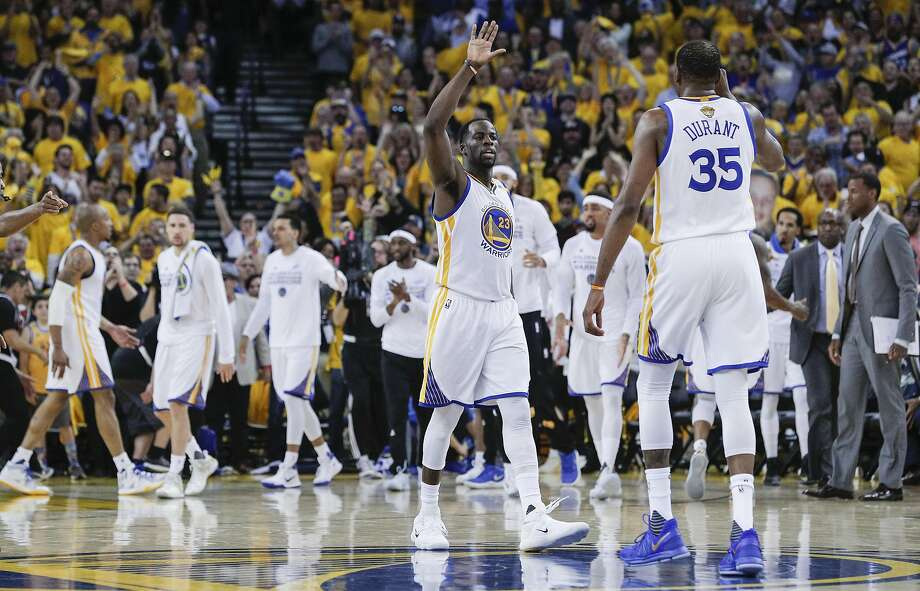 Golden State Warriors' Draymond Green and Kevin Durant go for a high five in the second quarter during Game 5 of the 2017 NBA Finals at Oracle Arena on Monday, June 12, 2017 in Oakland, Calif. Photo: Carlos Avila Gonzalez, The Chronicle