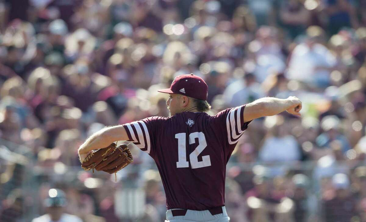 Texas A&M pitcher Corbin Martin (12) throws to home against Davidson during the second inning of an NCAA college baseball tournament super regional game Saturday, June 10, 2017, in College Station, Texas. Texas A&M won 12-6 to advance to the College World Series. (AP Photo/Sam Craft)