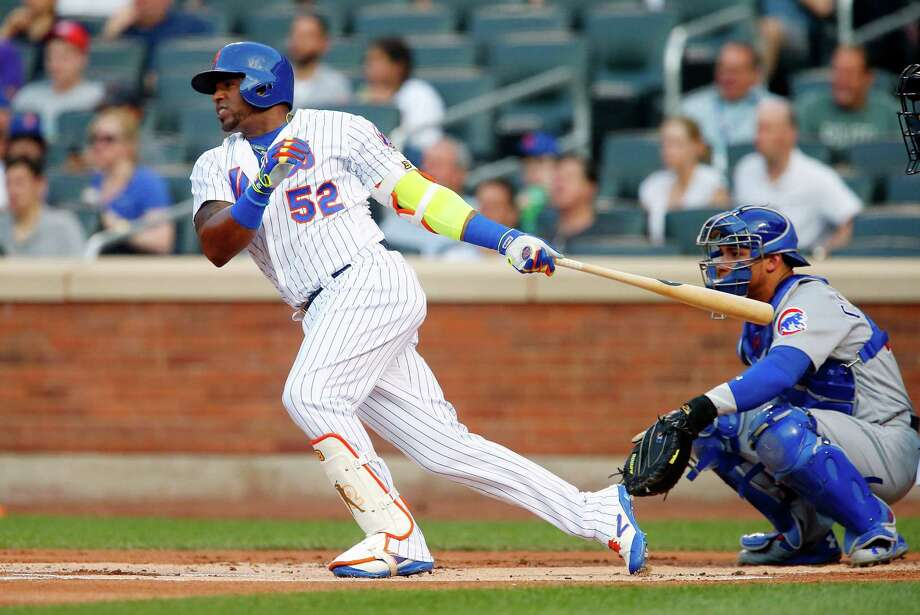 NEW YORK, NY - JUNE 12:  Yoenis Cespedes #52 of the New York Mets follows through on a first inning single against the Chicago Cubs at Citi Field on June 12, 2017 in the Flushing neighborhood of the Queens borough of New York City.  (Photo by Jim McIsaac/Getty Images) ORG XMIT: 700011202 Photo: Jim McIsaac / 2017 Getty Images