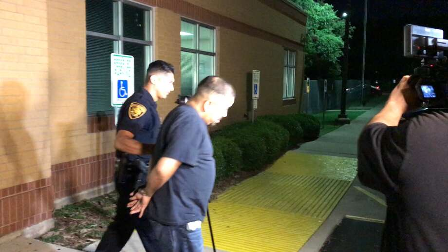 A 35-year-old man Sergio Morales Carrasco was led away in handcuffs by a  San Antonio Police Department officer Monday June 12, 2017, outside the  Prue substation, 5020 Prue Road. Police said the man is facing a  charge of organized retail theft Photo: Jacob Beltran