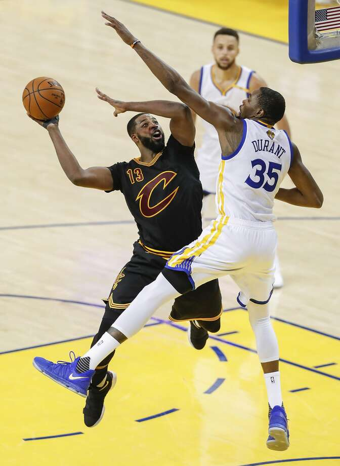 6eca5b7f3ef4 Golden State Warriors  Kevin Durant tries to stop Cleveland Cavaliers   Tristan Thompson in the