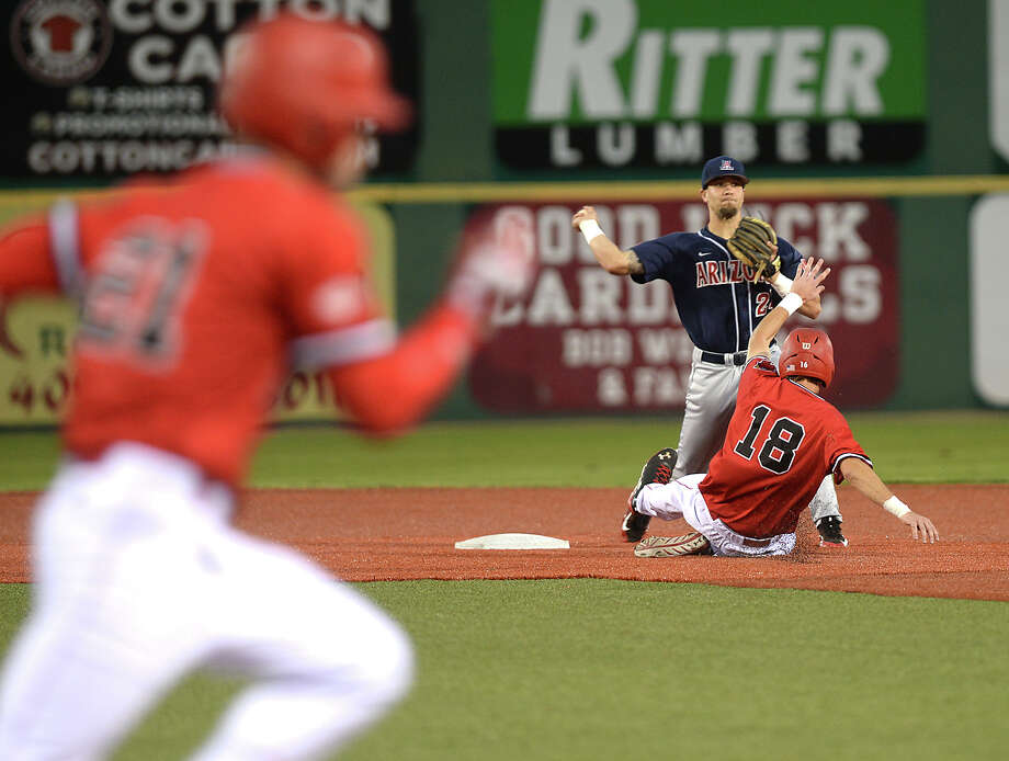 Lamar's Stijn VanDerMeer slides into second as Arizona's J.J. Matijevic looks to turn the double play during Monday's game at Vincent-Beck Stadium. Photo taken Monday, February 22, 2016 Kim Brent/The Enterprise Photo: Kim Brent, Kim Brent/The Enterprise / Beaumont Enterprise