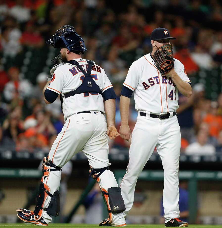Houston Astros relief pitcher Chris Devenski (47) talks with catcher Brian McCann (16) during the sixth inning of an MLB game at Minute Maid Park, Monday, June, 12, 2017. Photo: Karen Warren, Houston Chronicle / 2017 Houston Chronicle