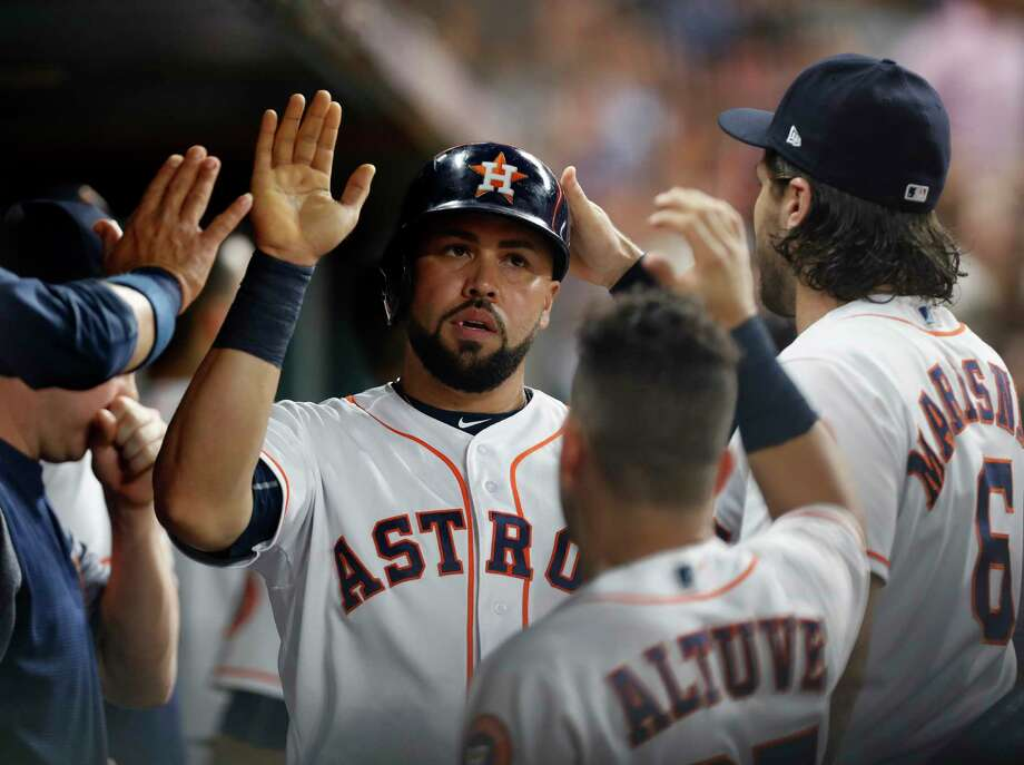 Houston Astros designated hitter Carlos Beltran (15) celebrates his run scored on Alex Bregman's RBI single, breaking up Texas Rangers starting pitcher Yu Darvish's no hitter during the sixth inning of an MLB game at Minute Maid Park, Monday, June, 12, 2017. Photo: Karen Warren, Houston Chronicle / 2017 Houston Chronicle
