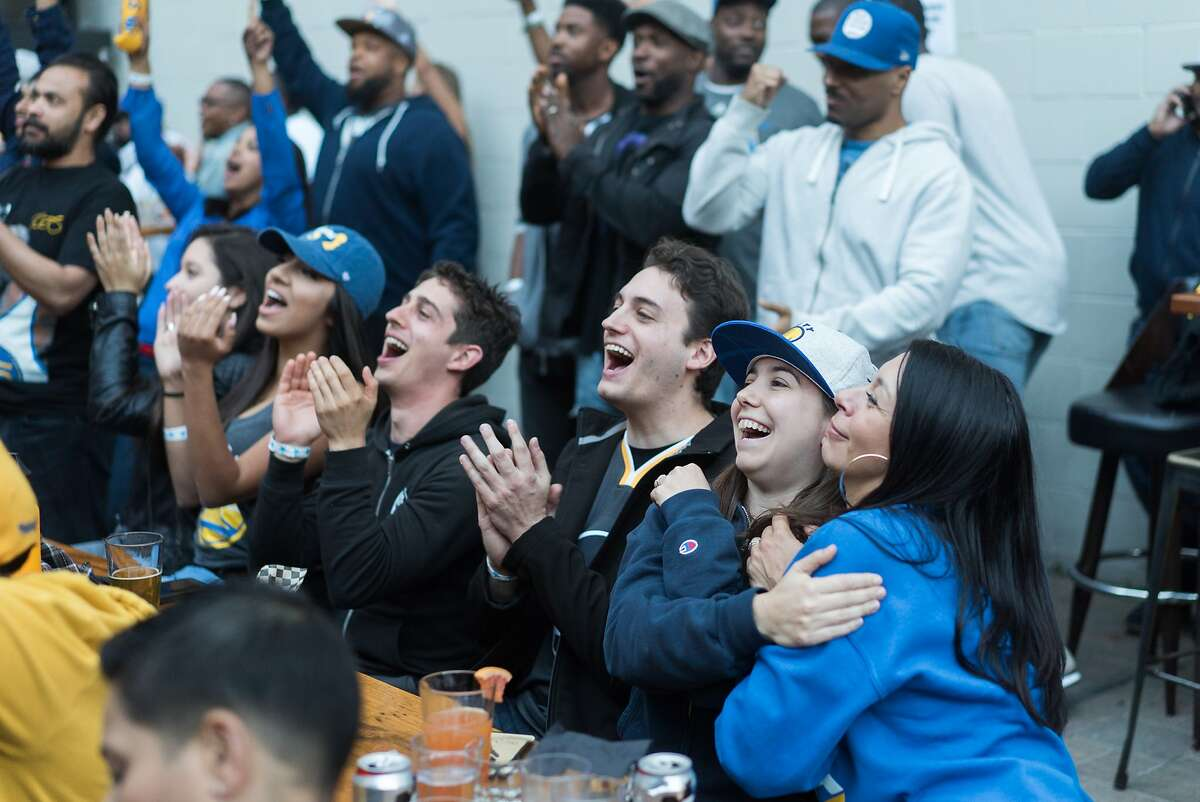 Fans react to Game 5 of the NBA Finals at Mad Oak in Oakland, Calif. on Monday, June 12, 2017. The Golden State Warriors played the Cleveland Cavaliers in Game 5 of the NBA Finals.