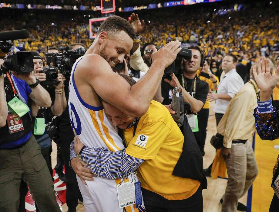 Golden State Warriors' Stephen Curry gets a hug from a fan after the Golden State Warriors defeated the Cleveland Cavaliers 129-120 during Game 5 to win the 2017 NBA Finals at Oracle Arena on Monday, June 12, 2017 in Oakland, Calif. Photo: Carlos Avila Gonzalez, The Chronicle