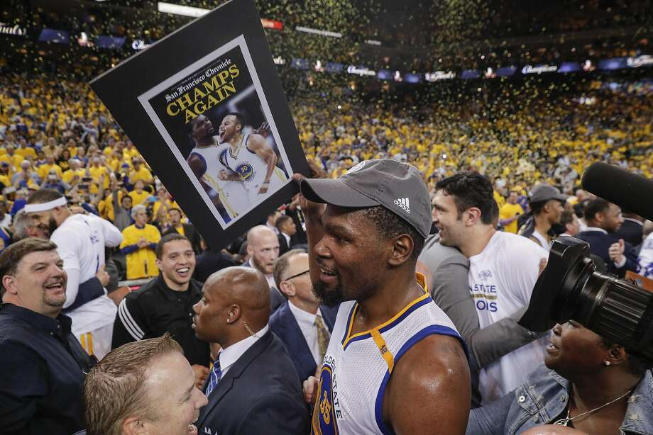 Golden State Warriors' Kevin Durant walks through the crowd after the Golden State Warriors defeated the Cleveland Cavaliers 129-120 during Game 5 to win the 2017 NBA Finals at Oracle Arena on Monday, June 12, 2017 in Oakland, Calif. Photo: Carlos Avila Gonzalez, The Chronicle