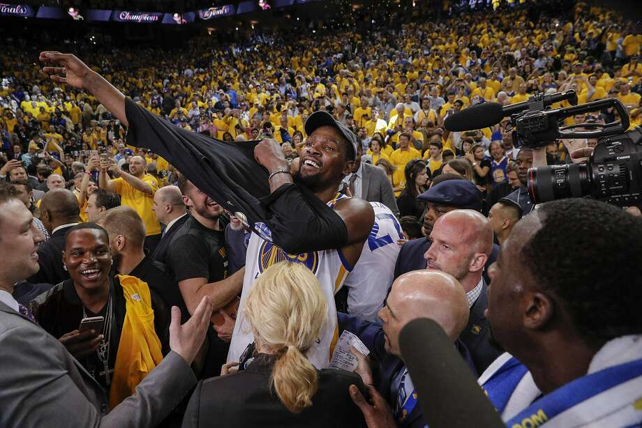 Golden State Warriors' Kevin Durant puts on his championship tshirt after Game 5 of the 2017 NBA Finals at Oracle Arena on Monday, June 12, 2017 in Oakland, Calif. Photo: Carlos Avila Gonzalez, The Chronicle
